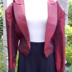Red tafetta jacket, black lining: size 16